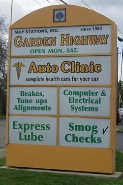 Garden Hwy Auto Clinic street sign